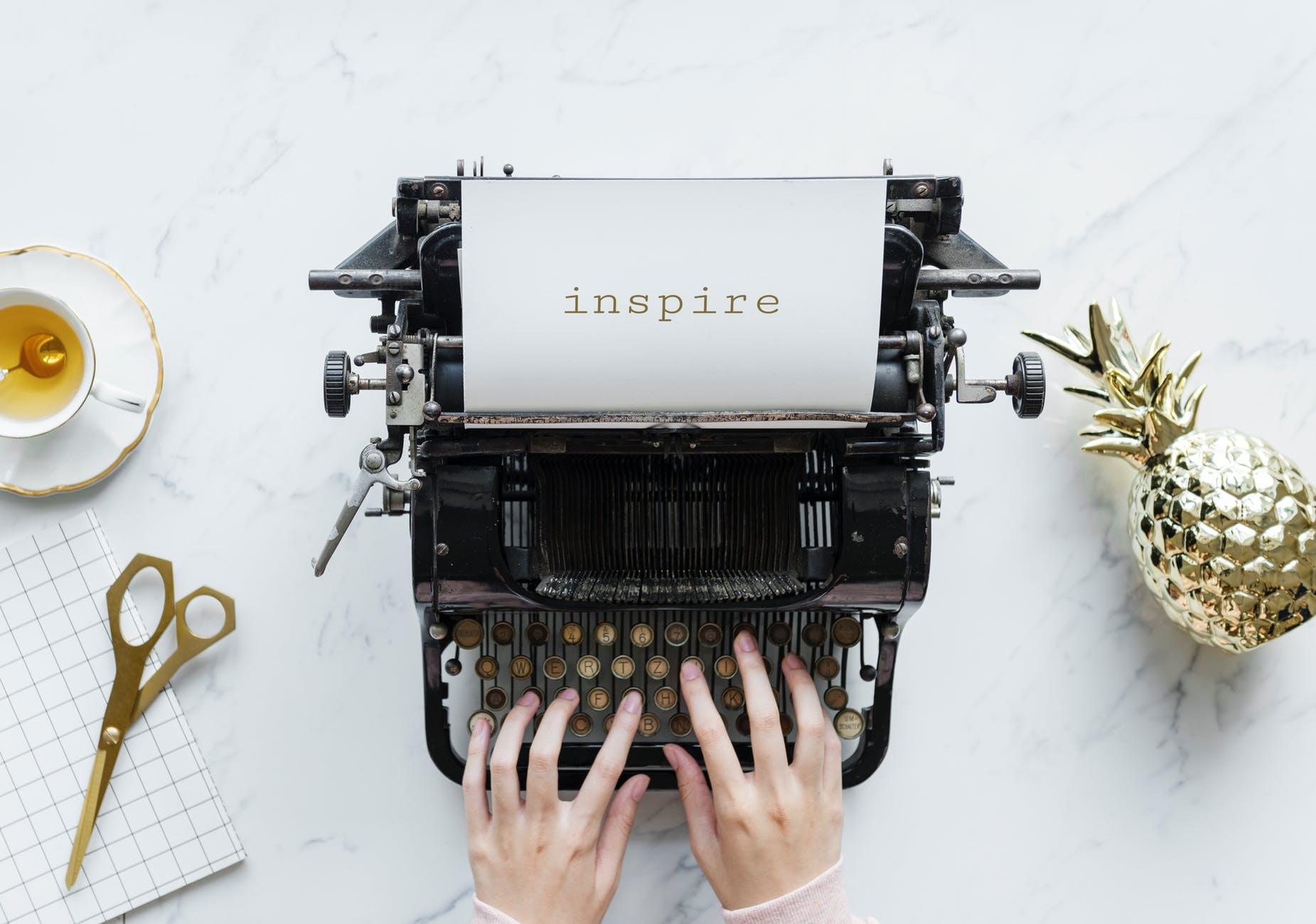 person using inspire typewriter